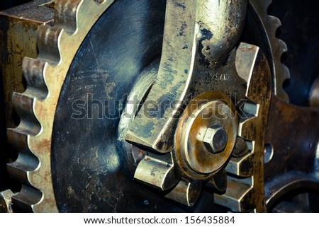 Close up of old metal gears - stock photo