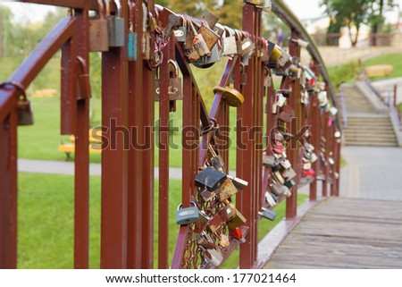 Close up of old padlocks hanging on bridge in park. Grodno, Belarus - stock photo