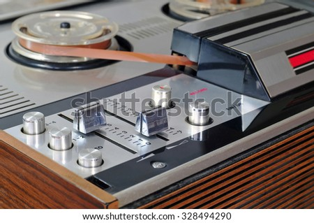 Close up of old reel to reel tape player and recorder - stock photo