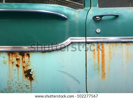 Close up of old rusty car door with space for your text