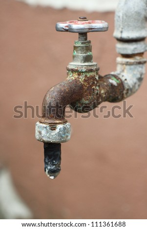 Close up of old rusty water tap, shallow Dof - stock photo