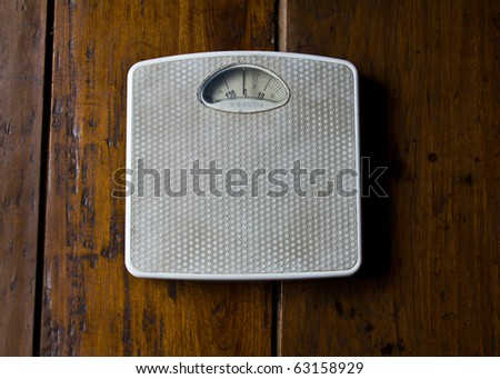 Close up of Old scale on wooden floor . - stock photo