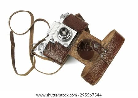 Close-up Of Old Shabby 35 mm Photo Film Camera leather Case Isolated On White Background - stock photo
