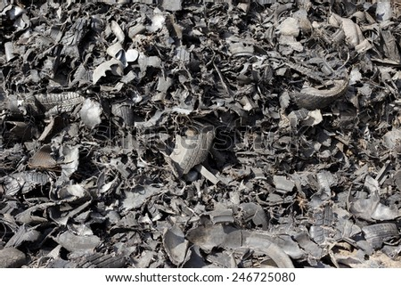 Close up of old shredded tires on pile - stock photo