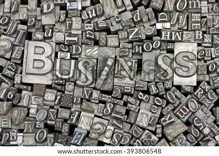Close up of old used metal typeset letters with the word Business. - stock photo