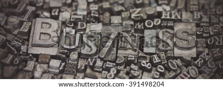 Close up of old used metal typeset letters with the word Business. Vintage filter applied. - stock photo