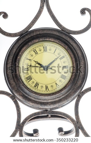close up of old vintage clock isolated on white - stock photo