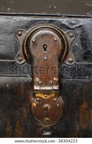 Close up of old wooden trunk lock - stock photo