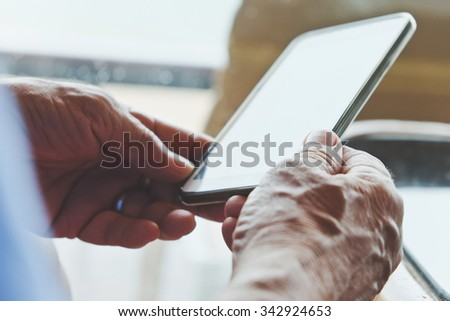 Close up of older man checking his phone background