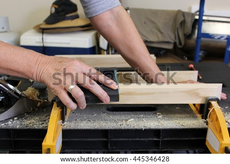 Close up of Older Woman sanding timber 3 - stock photo