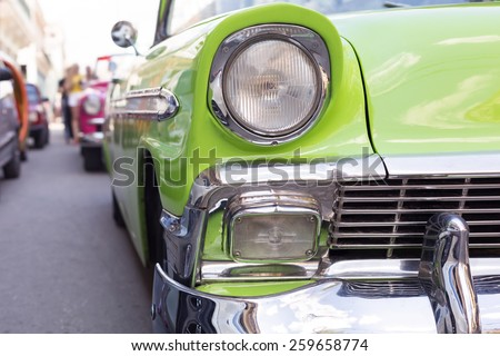 Close up of oldtimer headlight. Havana, Cuba. Shallow DOF. Toned - stock photo