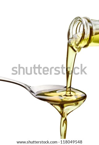 close up of olive oil on white background with clipping path - stock photo