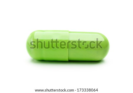 close up of one green capsule isolated on white background - stock photo