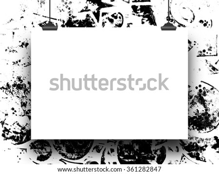 Close-up of one hanged paper sheet with clips on black and white ink splotchy background
