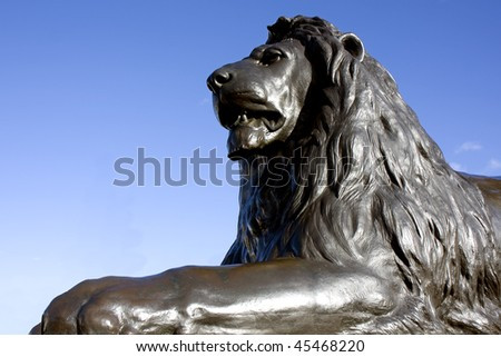 Close up of one of the bronze lions at Trafalgar Square, London, England.