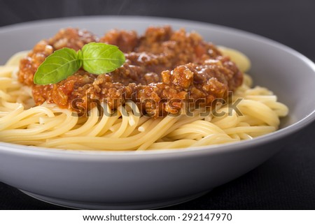 Close up of one plate with Spaghetti Bolognese - stock photo