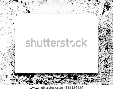Close-up of one poster paper sheet frame with nails on black and white splotchy ink background