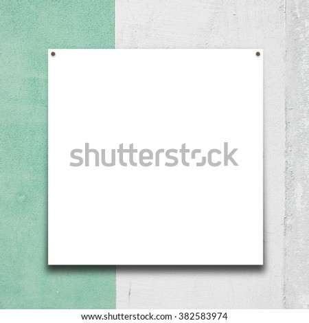 Close-up of one square paper sheet frame with nails on grey and aqua painted wall background