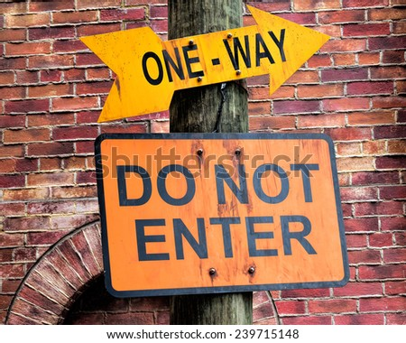 Close up of one way and do not enter sign, selective focus.  - stock photo
