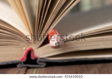 Close-up of open book and pen. Back to school. - stock photo