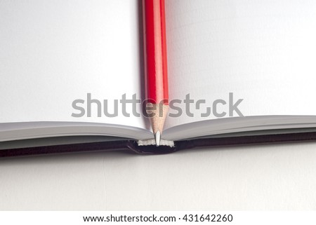Close-up of open book and pen. Copy space for text. - stock photo