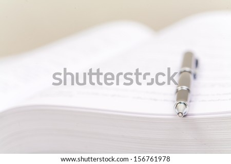 Close-up of open book and pen, White - stock photo
