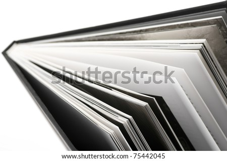 Close-up of open book. Shallow DOF. - stock photo
