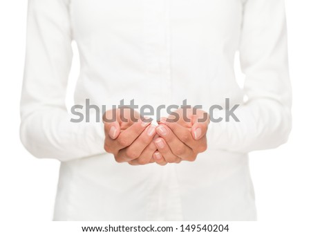 Close up of open female hands cupped together isolated on white background - stock photo