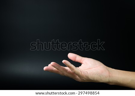 Close up of open hand on black background