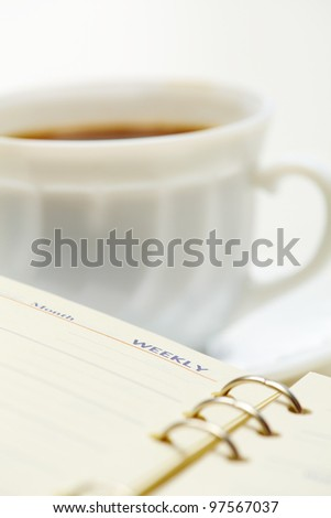 Close-up of open notepad at workplace