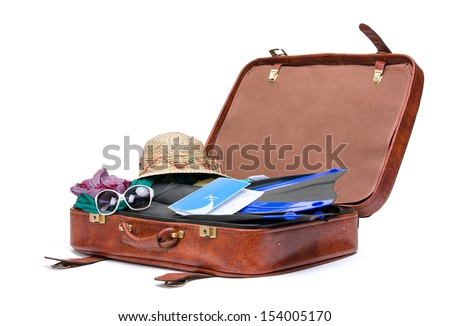 Close up of opened brown suitcase with clothing for traveling, isolated on white - stock photo