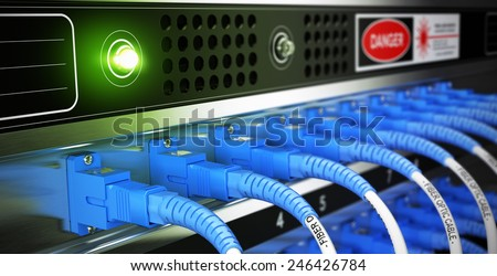 Close up of optical fiber optic active and passive equipment inside a network infrastructure. Blur effect with focus on one cable. - stock photo
