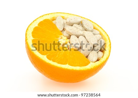 Close up of orange and pills isolated - vitamin concept - stock photo