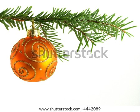 Close-up of orange Christmas bauble on tree against white background