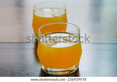 close up of orange juice with ice - stock photo