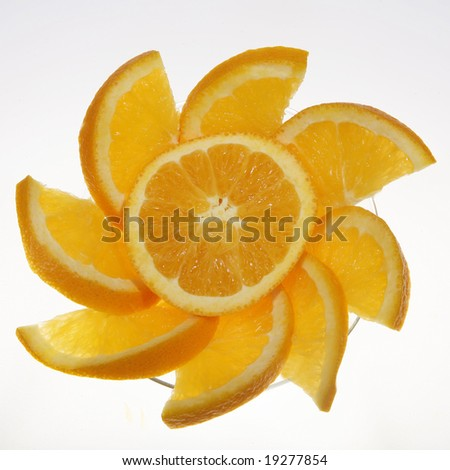 Close-up of orange slices fanned out in a martini glass