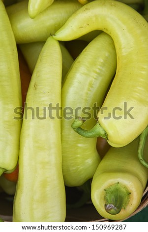 Close up of organic, fresh picked, long yellow peppers