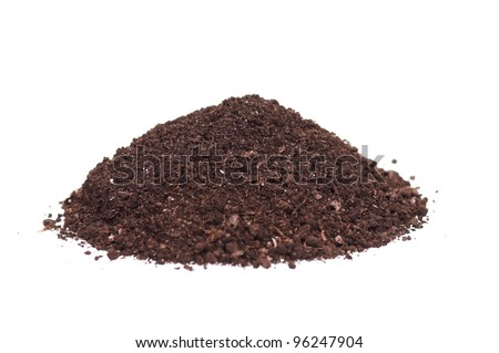 Close-up of organic soil isolated on white background