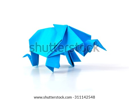 Close up of origami elephant isolated on white background, selective focus.