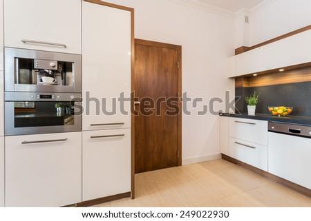 Close-up of oven and microwave housing unit - stock photo