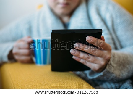 Close up of Overweight woman reading book - stock photo