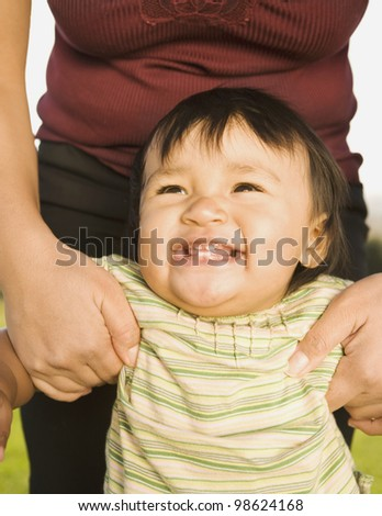 Close up of Pacific Islander baby smiling - stock photo