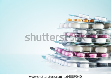 Close-up of  package of different drugs stack laying on the table with copy space - stock photo