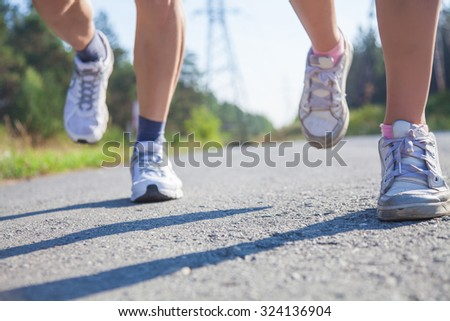 Close-up of pair of feet runners - stock photo