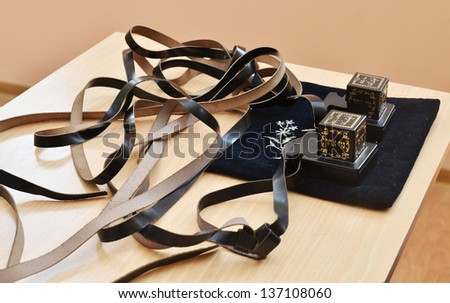 close up of pair of tfillin, jewish religious symbol - stock photo
