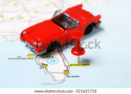 Close up of  Palm Beach   USA map with red pin and car - Travel concept - stock photo