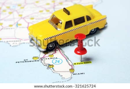 Close up of  Palm Beach   USA map with red pin and taxi  - Travel concept - stock photo