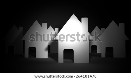 Close up of paper houses on black background - stock photo