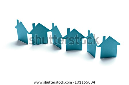 close up of  paper houses on white background - stock photo