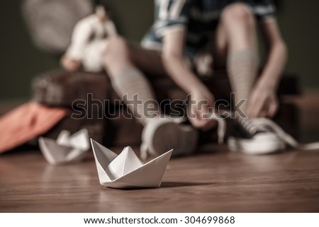 Close-up of paper ship on the floor - stock photo